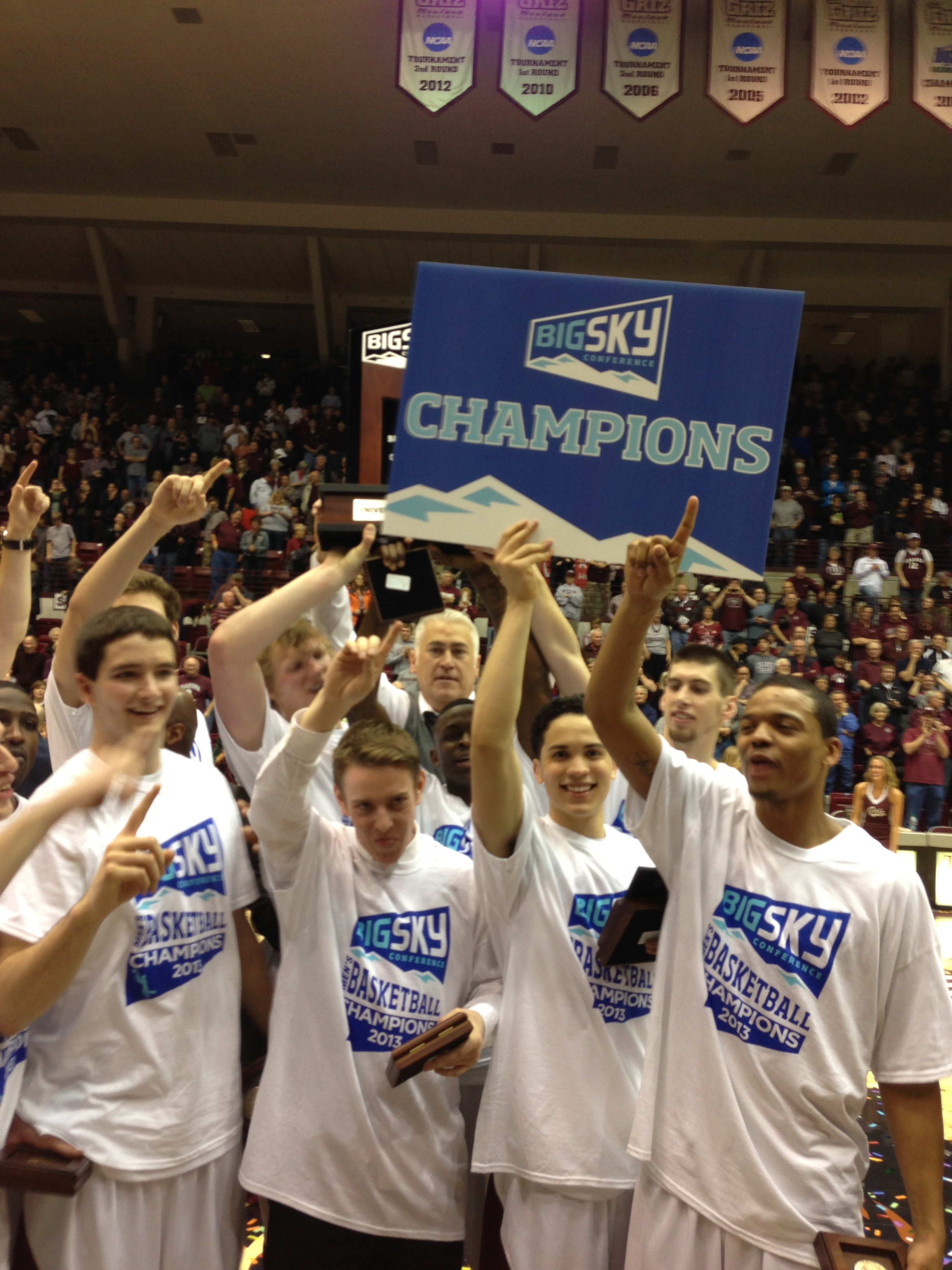 Members of the Griz basketball team celebrating after the game.