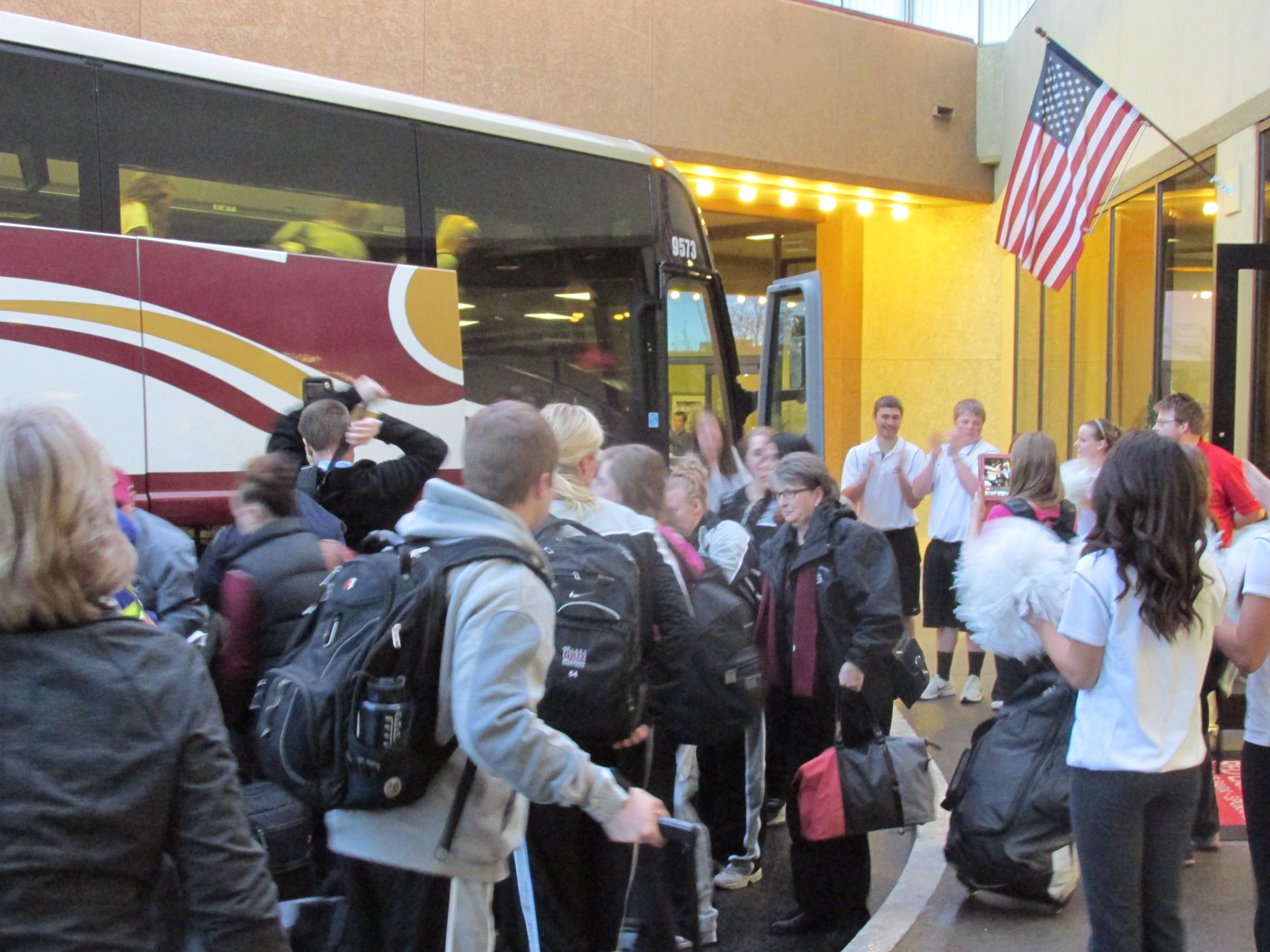 The Lady Griz getting off the bus and getting welcomed by the Cheer Squad.