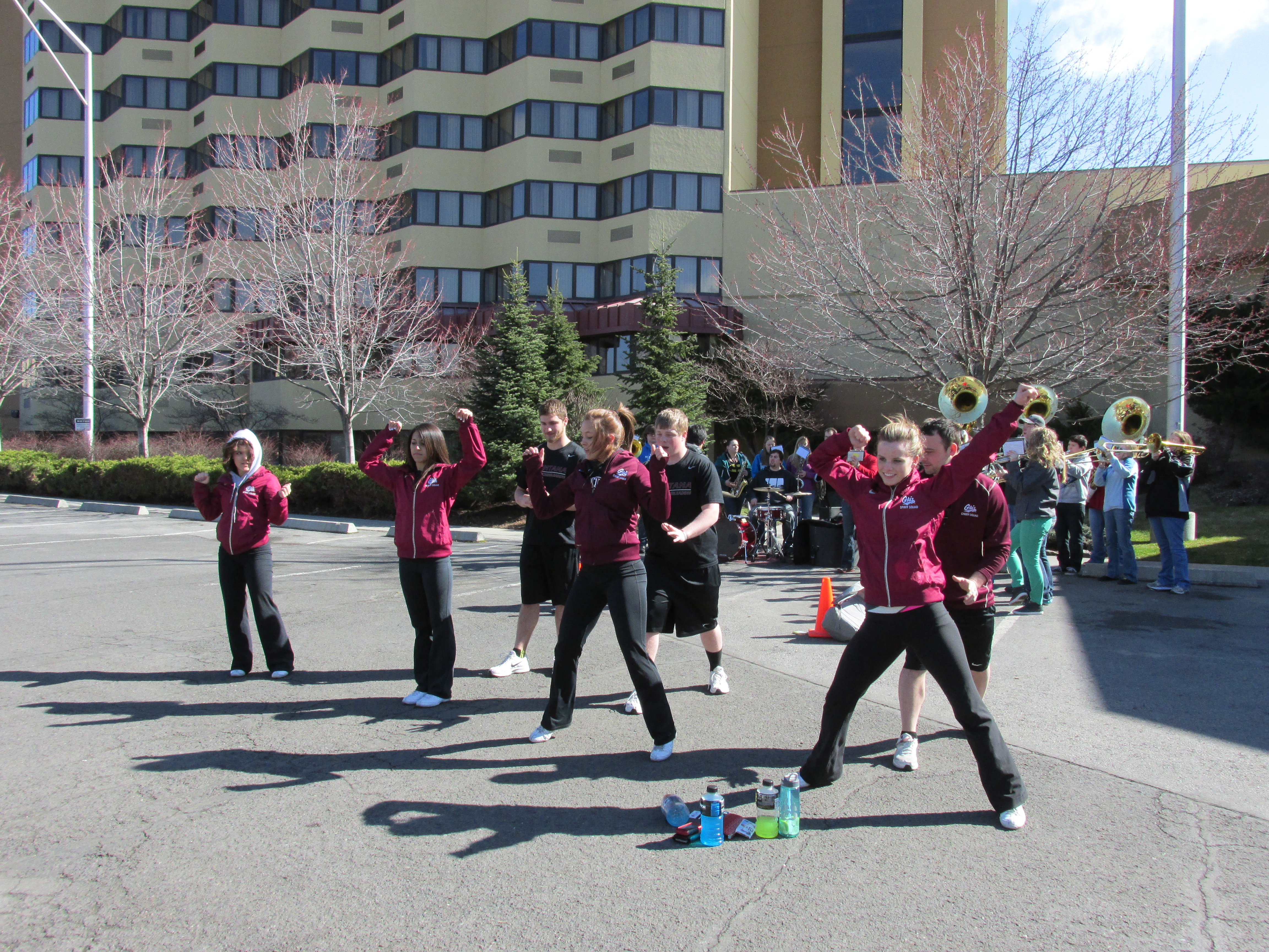 The Cheer Squad and Pep Band rehearsing in the Red Lion parking lot.