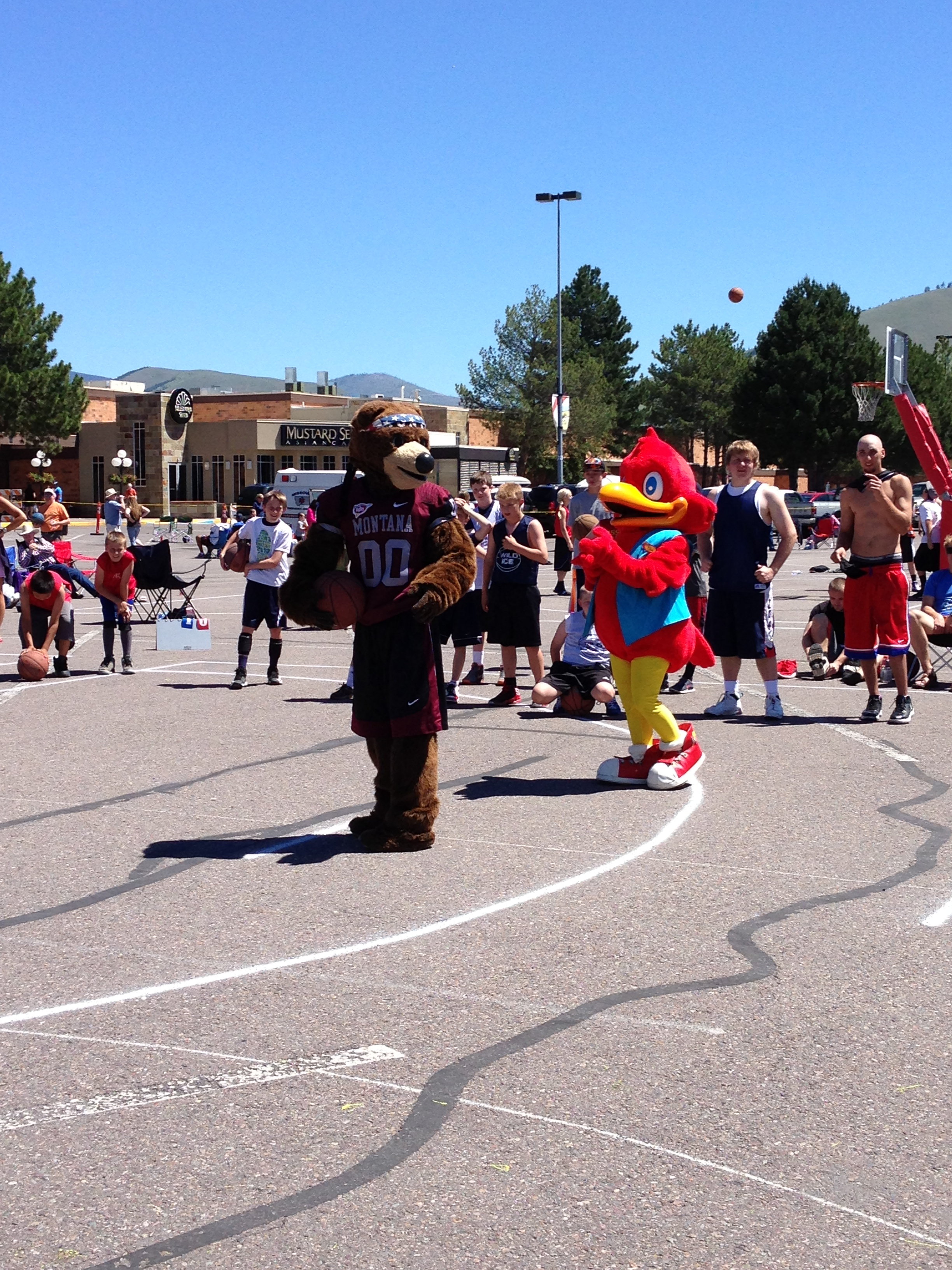 Monte interacting with the Red Robin mascot.
