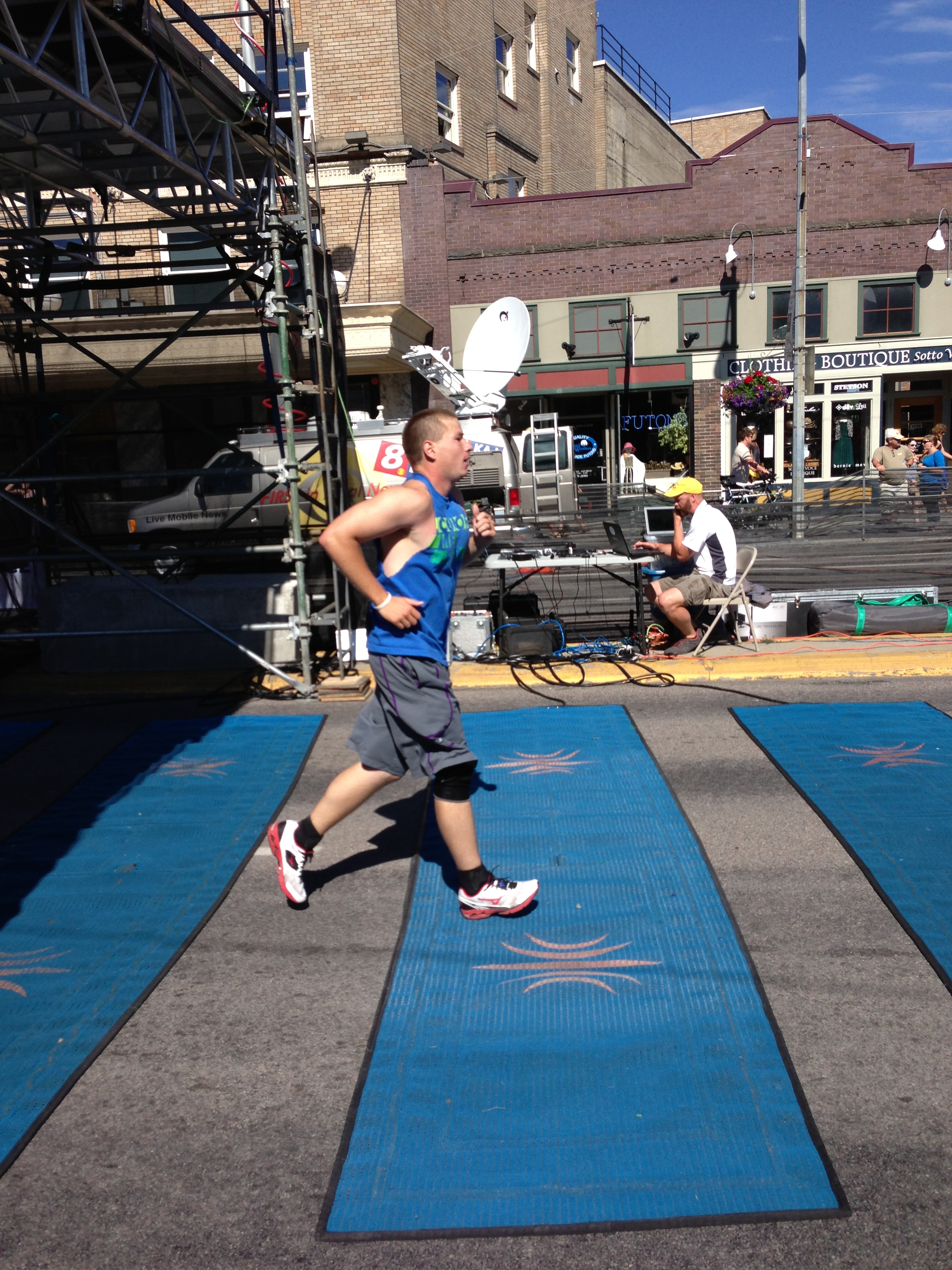 Shaun crossing the Missoula Marathon finish line at a little under four and a half hours.