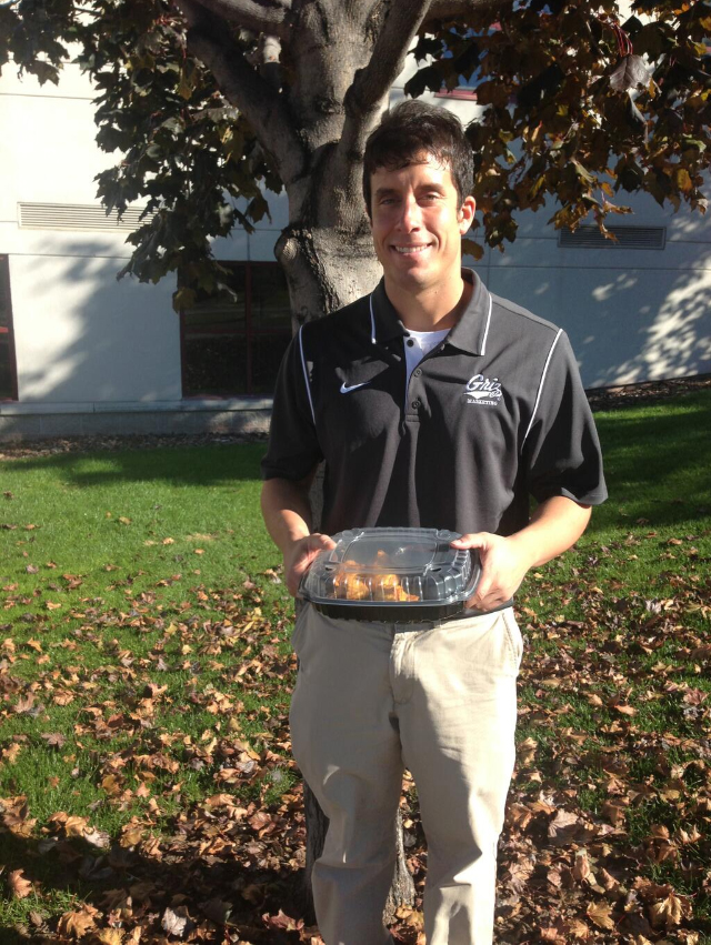 Me standing with the cookie dough dessert that was delivered by HuHot to my office.