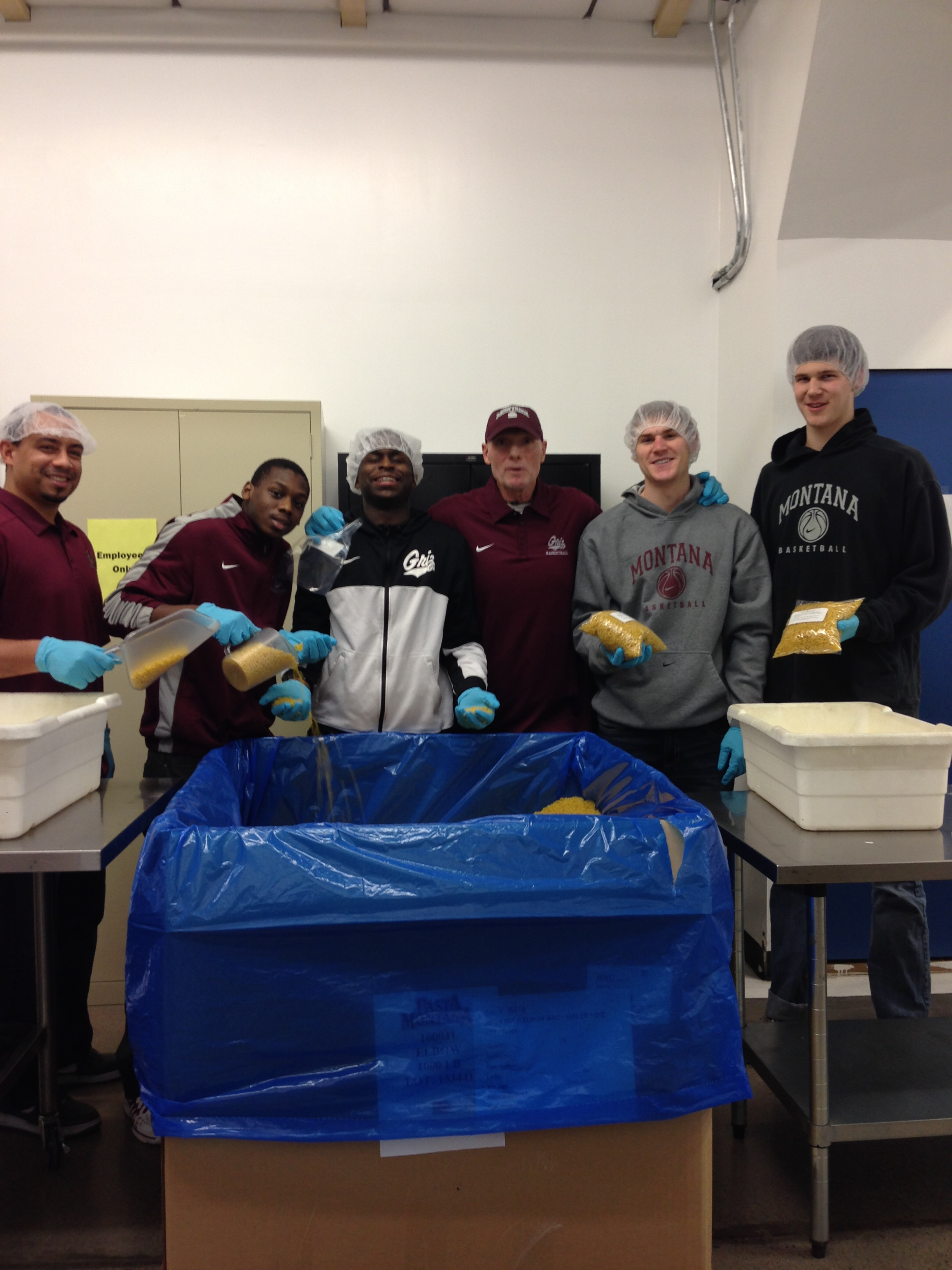 Players and coaches from the Griz basketball team volunteered tonight at the Montana Food Bank Network.