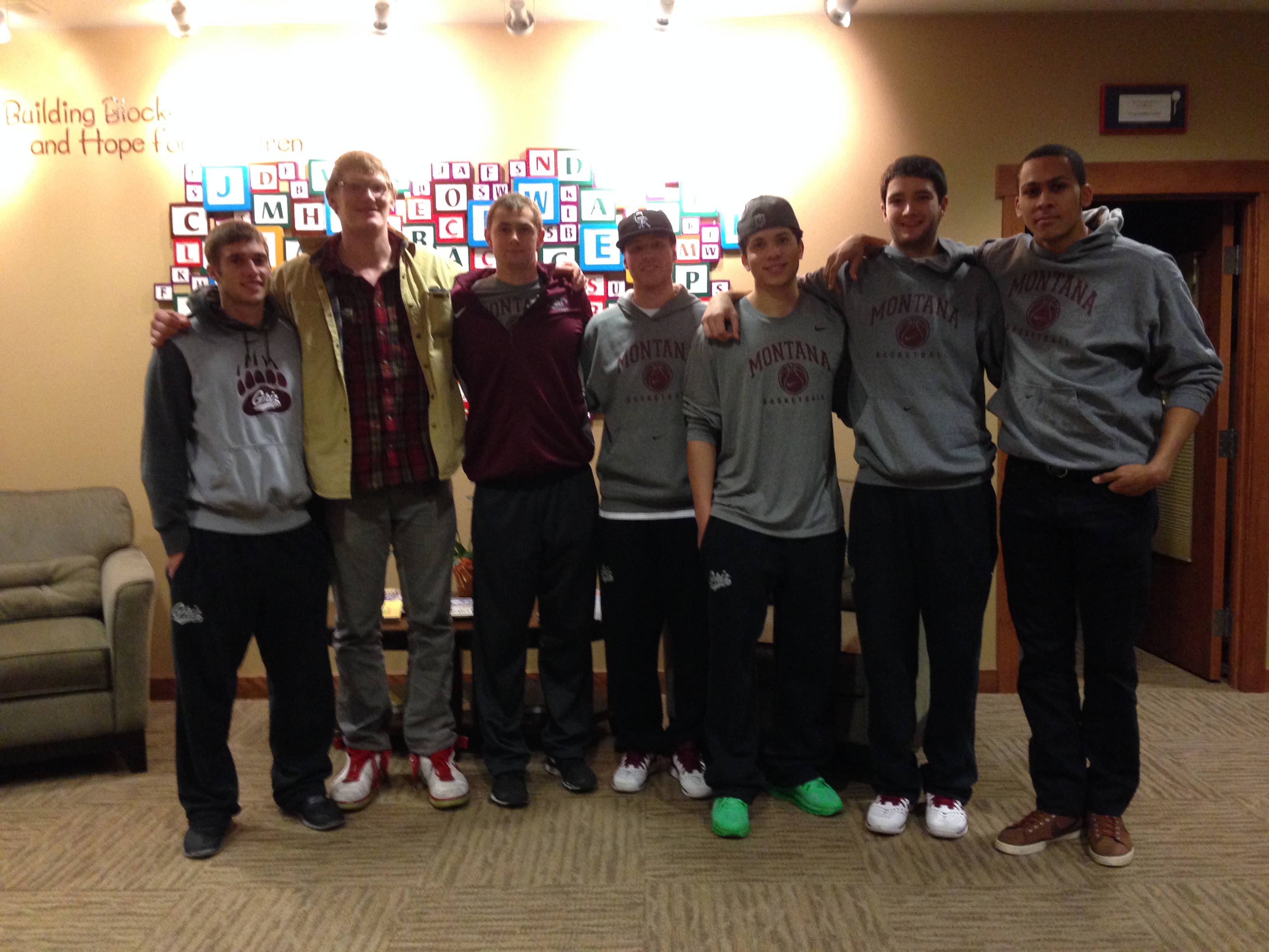 Members of the Griz basketball team who volunteered at the Watson Children's Center tonight.