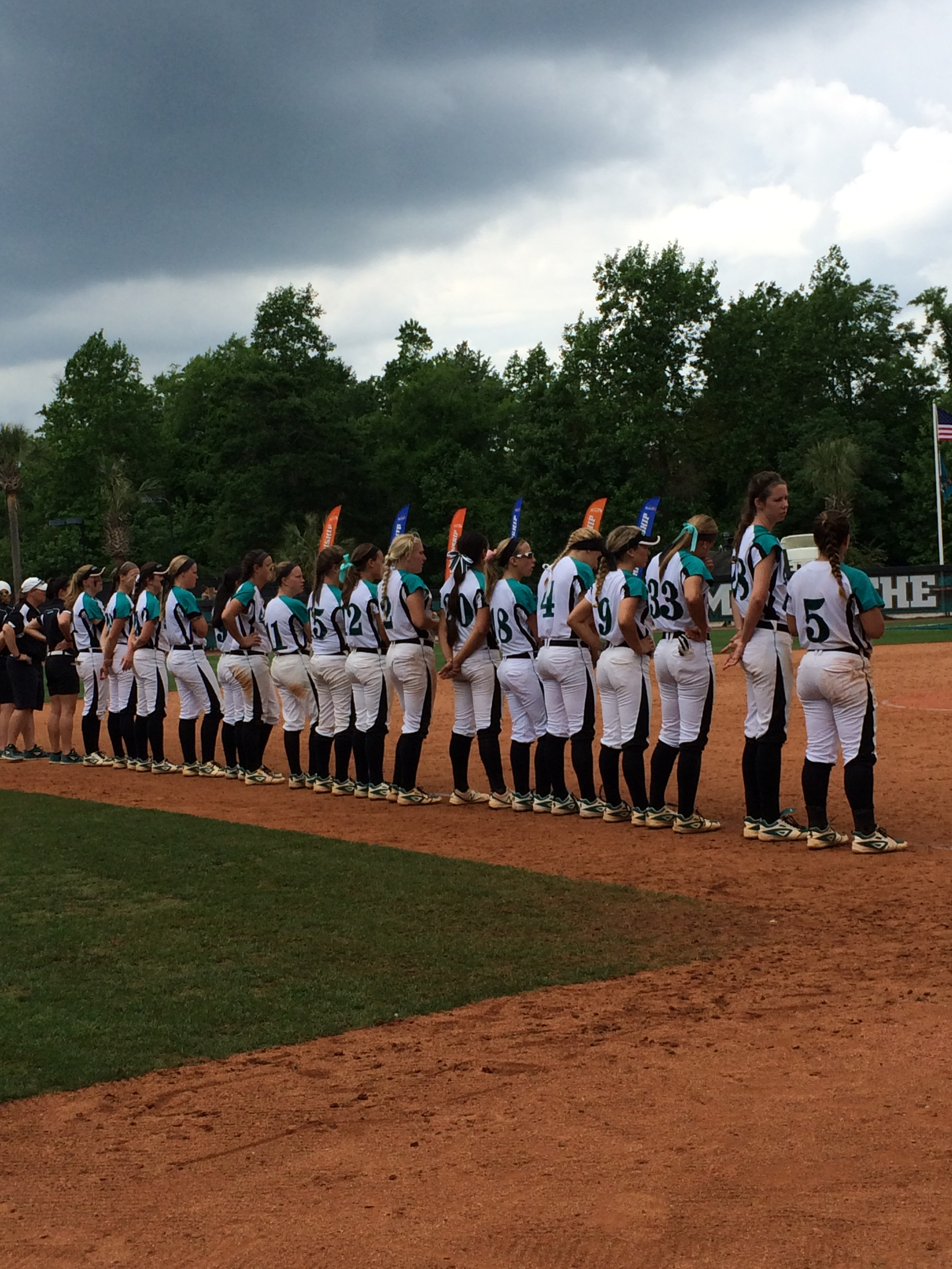 The CCU softball team stands during the awards ceremony today.