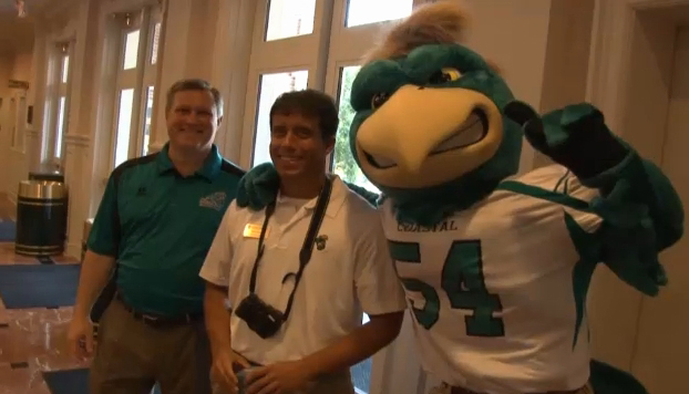 My surprised face as I stand between Coastal Carolina University Athletic Director Matt Hogue and Chauncey.