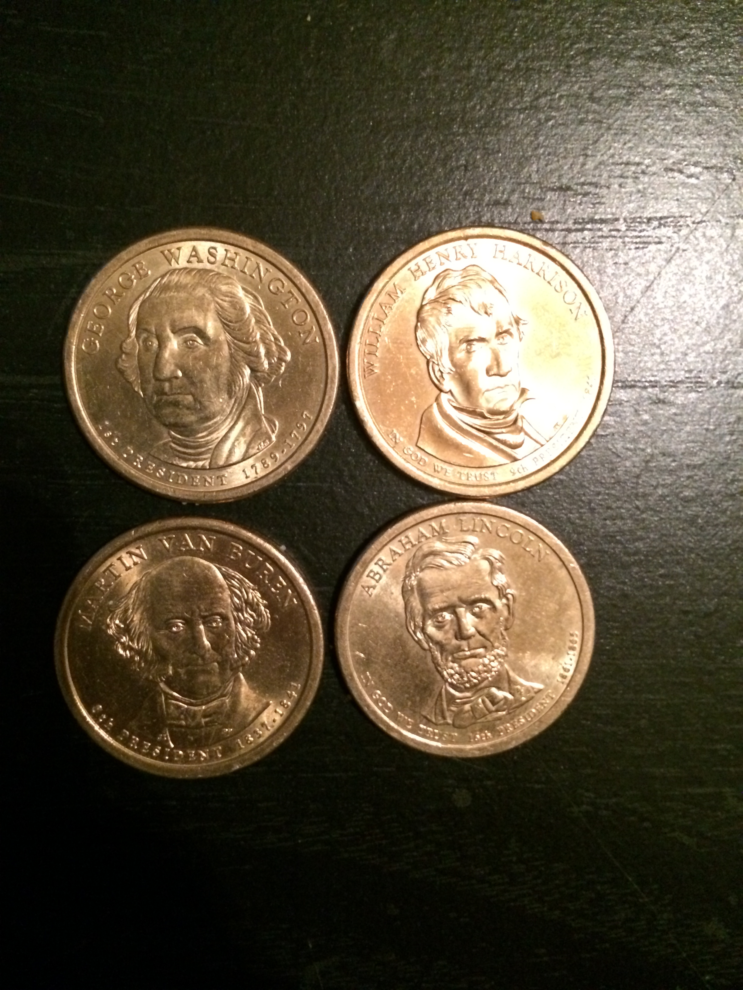 An up close look at the four Presidential dollar coins I received.
