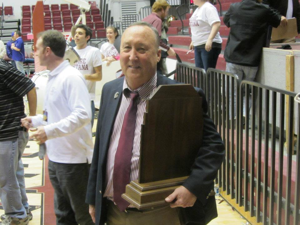 Dave Guffey with the Big Sky Conference championship trophy after the men's basketball team clinched a spot in the NCAA Tournament in 2012.