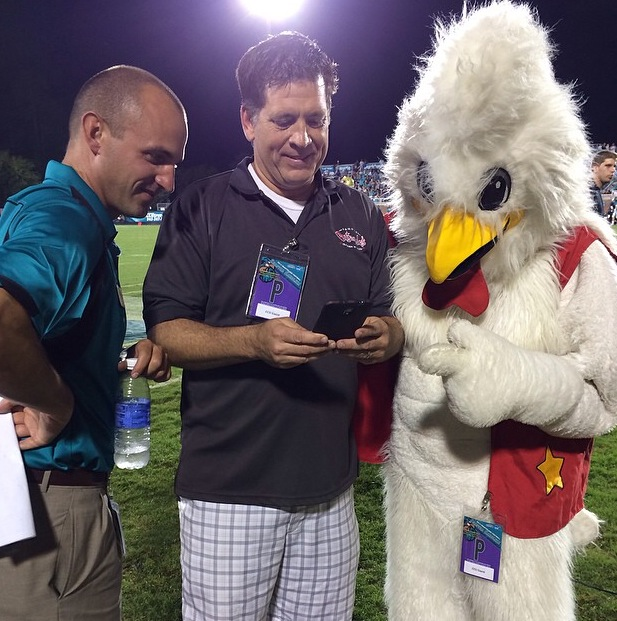 Seth Horton (left), Bojangles representative (center), and the Bojangles chicken (right) look on as tweets start to pour in at the September 27 game.