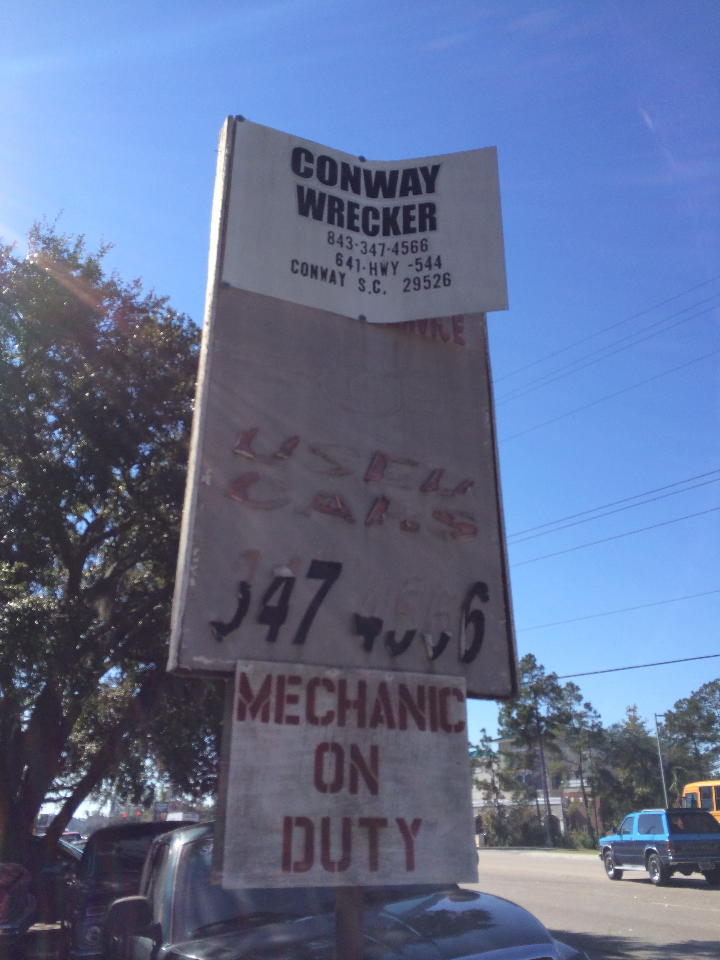 "This is the sign at Conway Wreckers. Notice the ""Mechanic on Duty"" sign."