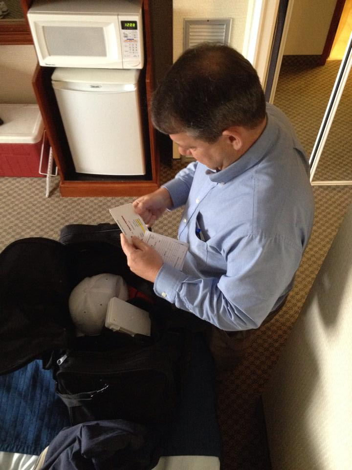My dad getting his officiating bag ready before leaving the hotel for the dome.