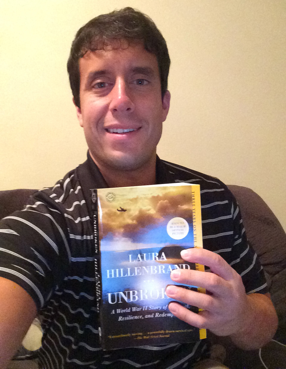 "Me with the book I purchased, ""Unbroken."""