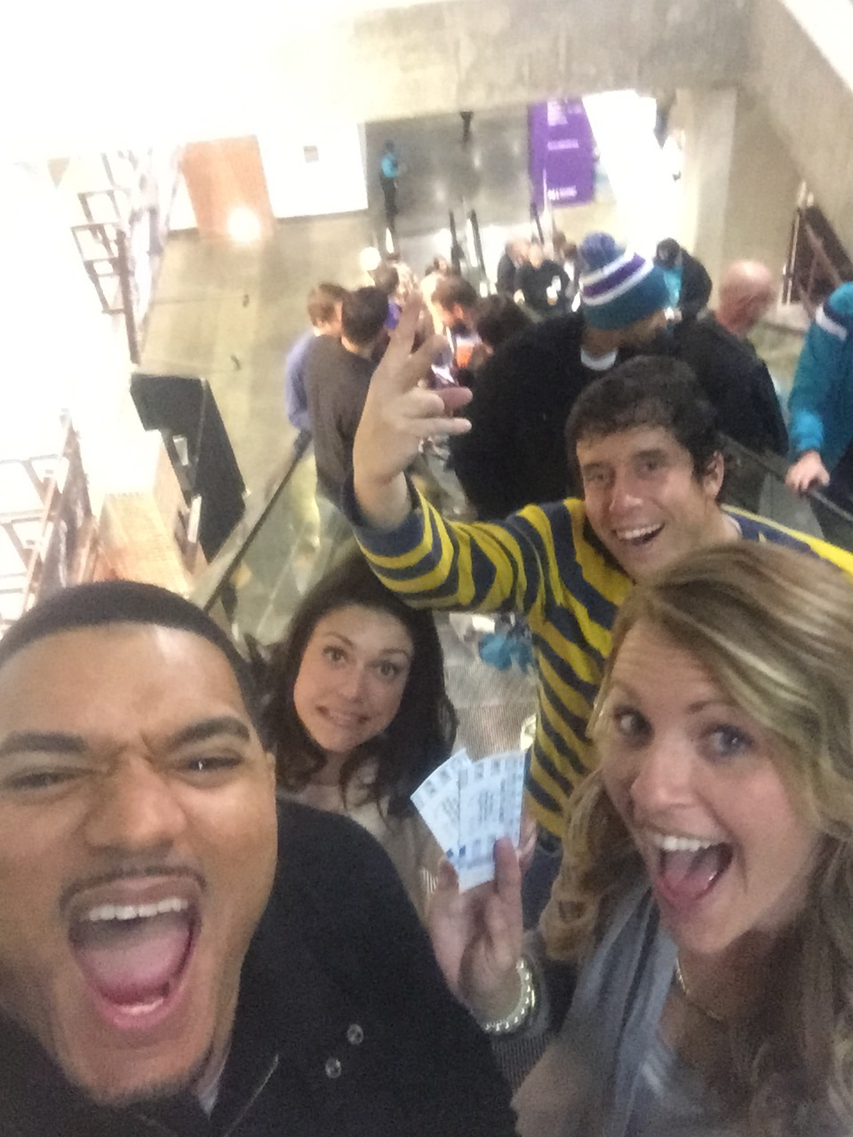 Eric, Alia, Sidney, and I  (obviously excited) in Time Warner Arena going to our seats.