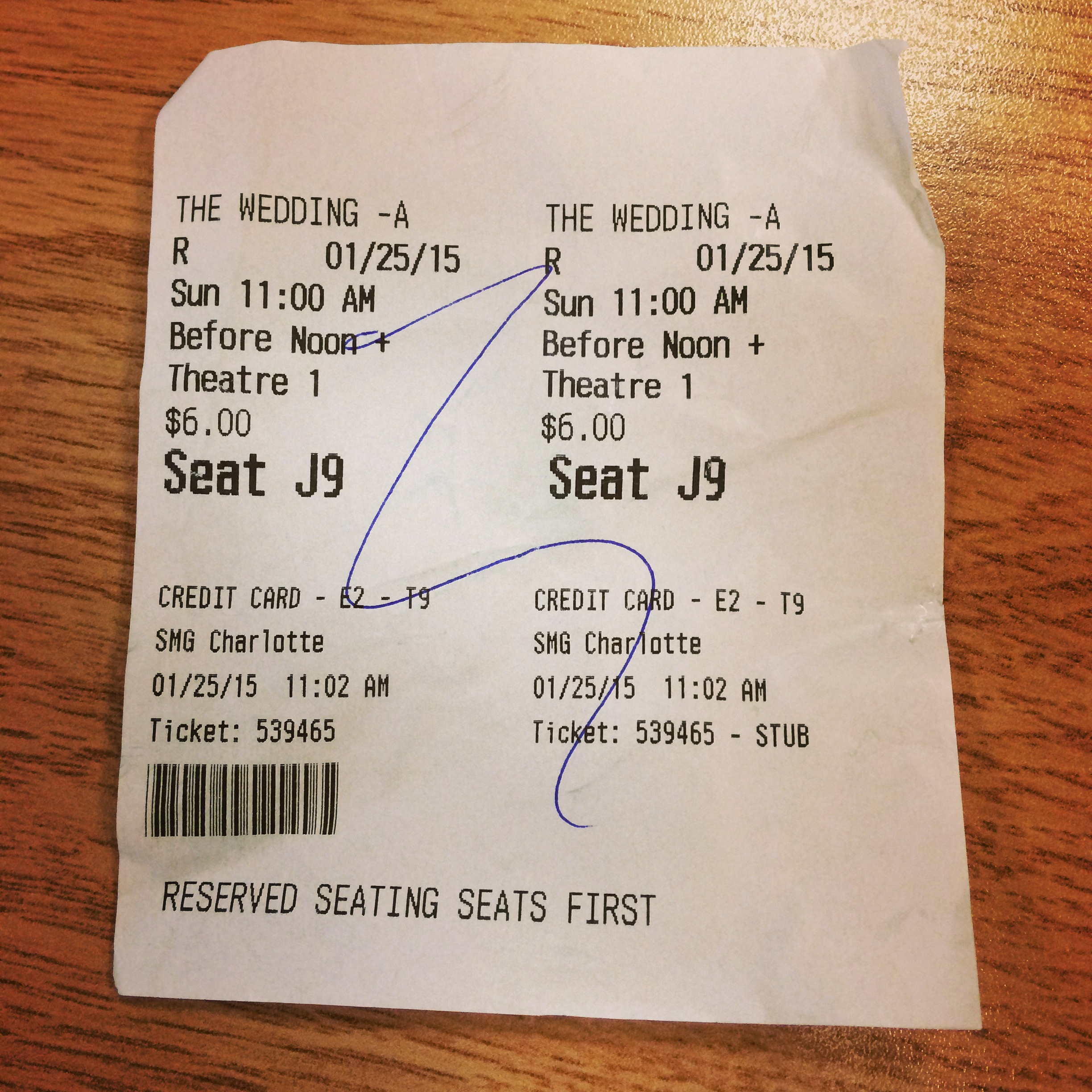 "Our tickets for ""The Wedding Ringer"" at Movie Studio Grill."