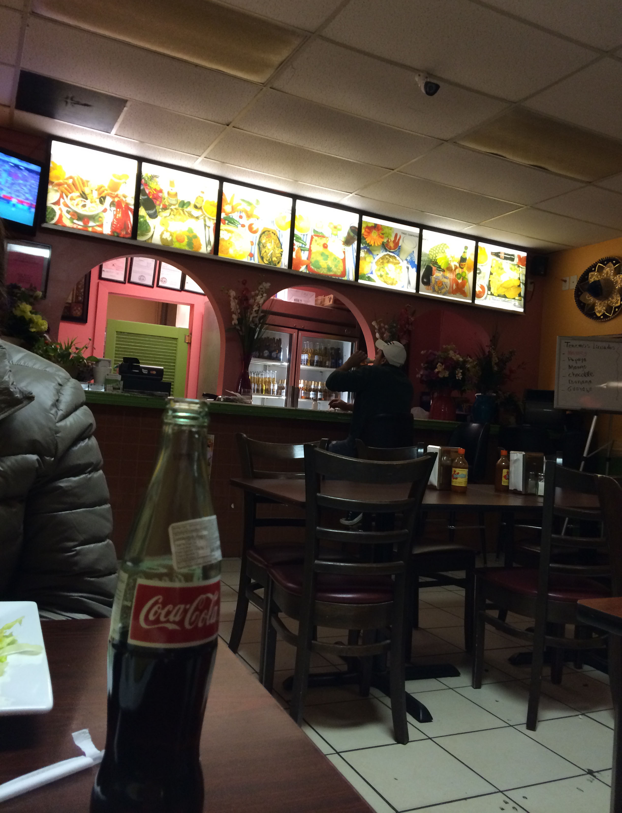 This is the inside of the restaurant. You can see Sidney's Mexican imported Coca-Cola.