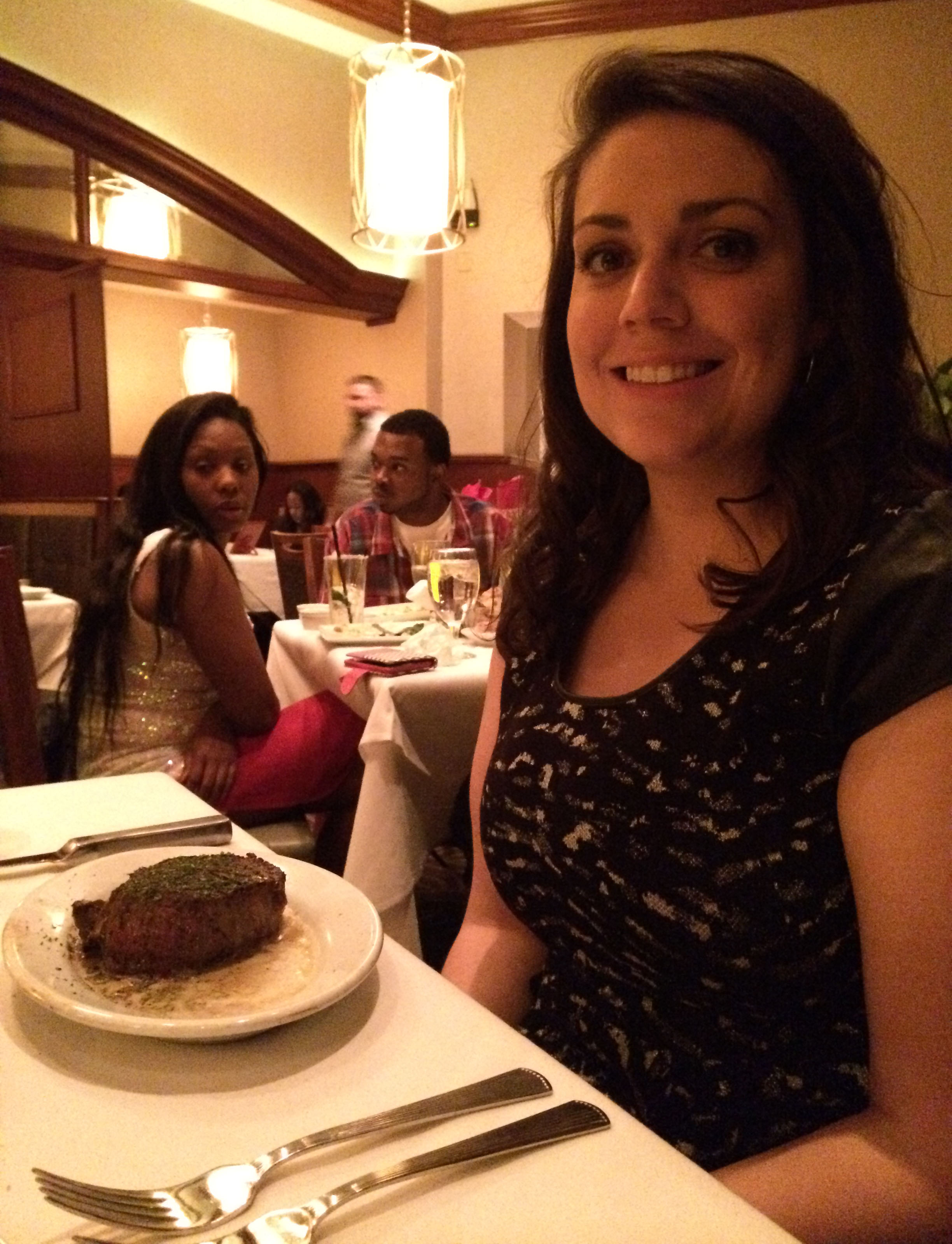 Sid with her steak. The girl who asked aloud why they didn't order the onion rings is in clear view.