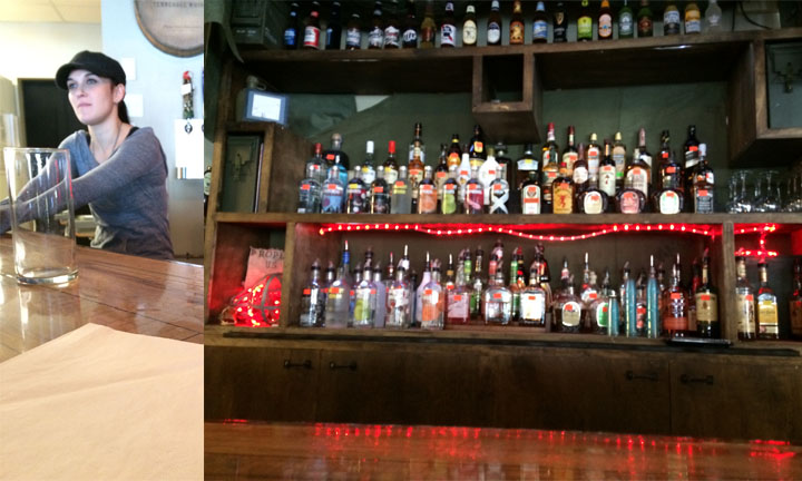 Our bartender on the left with the bottle display on the right.