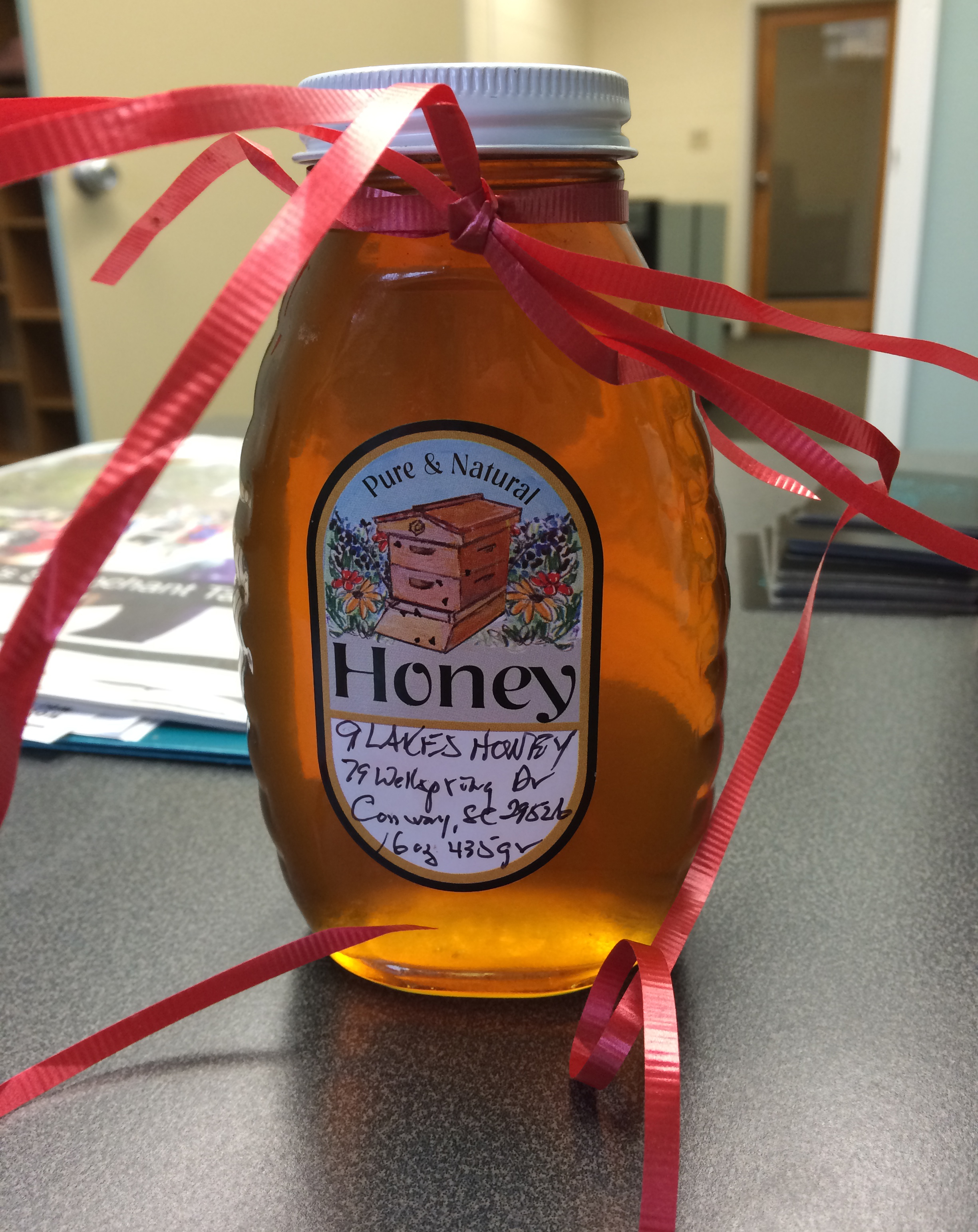 Martha presented me with this jar of 9 Lakes Honey.