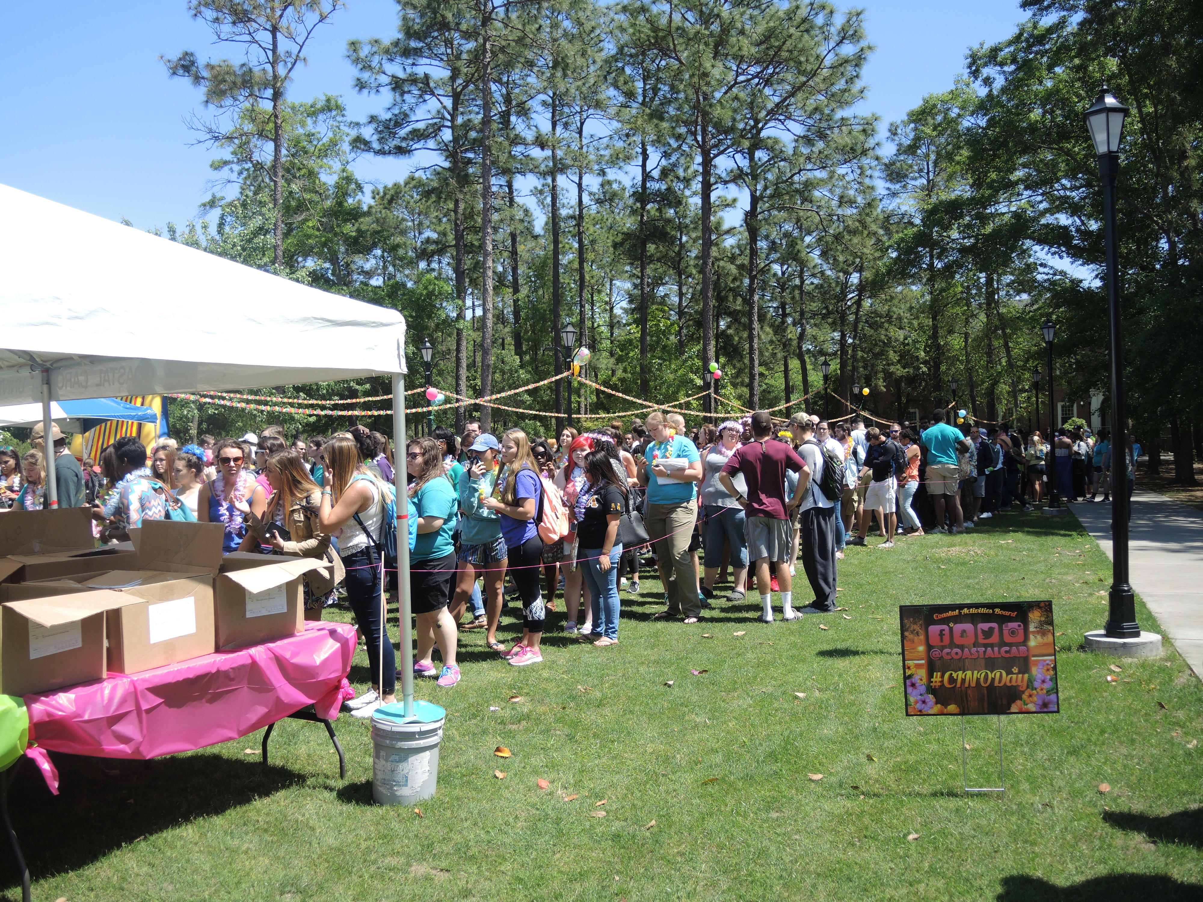 Students lined up well before the noon start time of CINO Day so they could get the free shirt of this year's event.