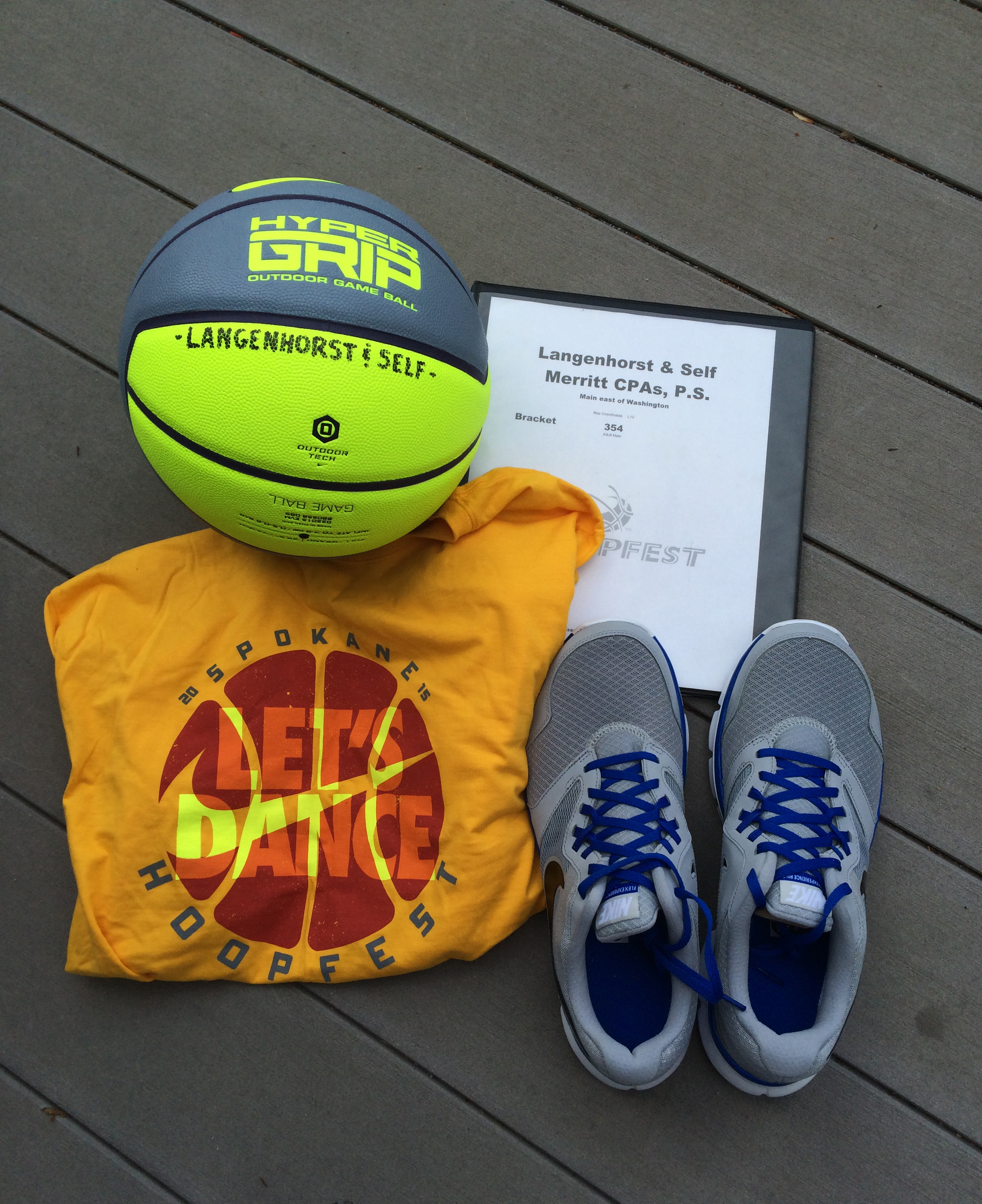 2015 Hoopfest court monitor t-shirt with my bracket book, the ball, and shoes.