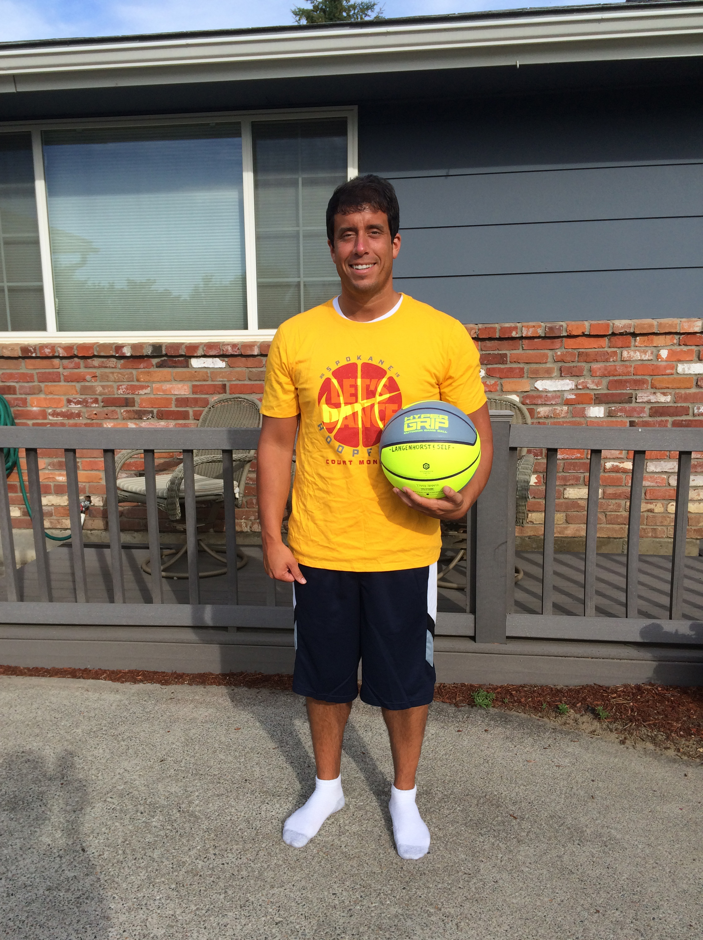 This is me wearing the 2015 Hoopfest t-shirt and shorts while holding the 2015 Hoopfest ball.
