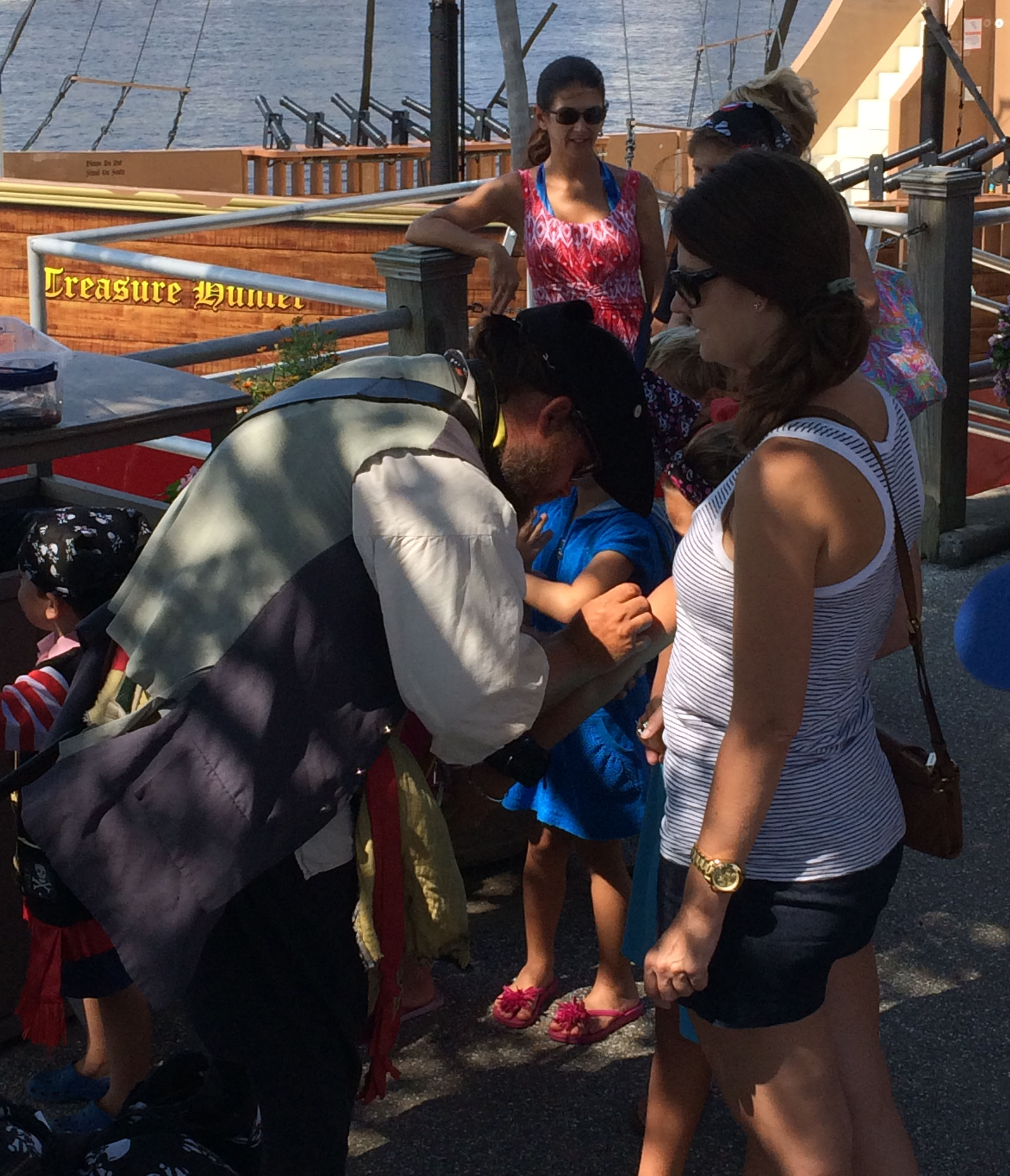 A pirate doing a little bit of face and arm painting before we boarded.