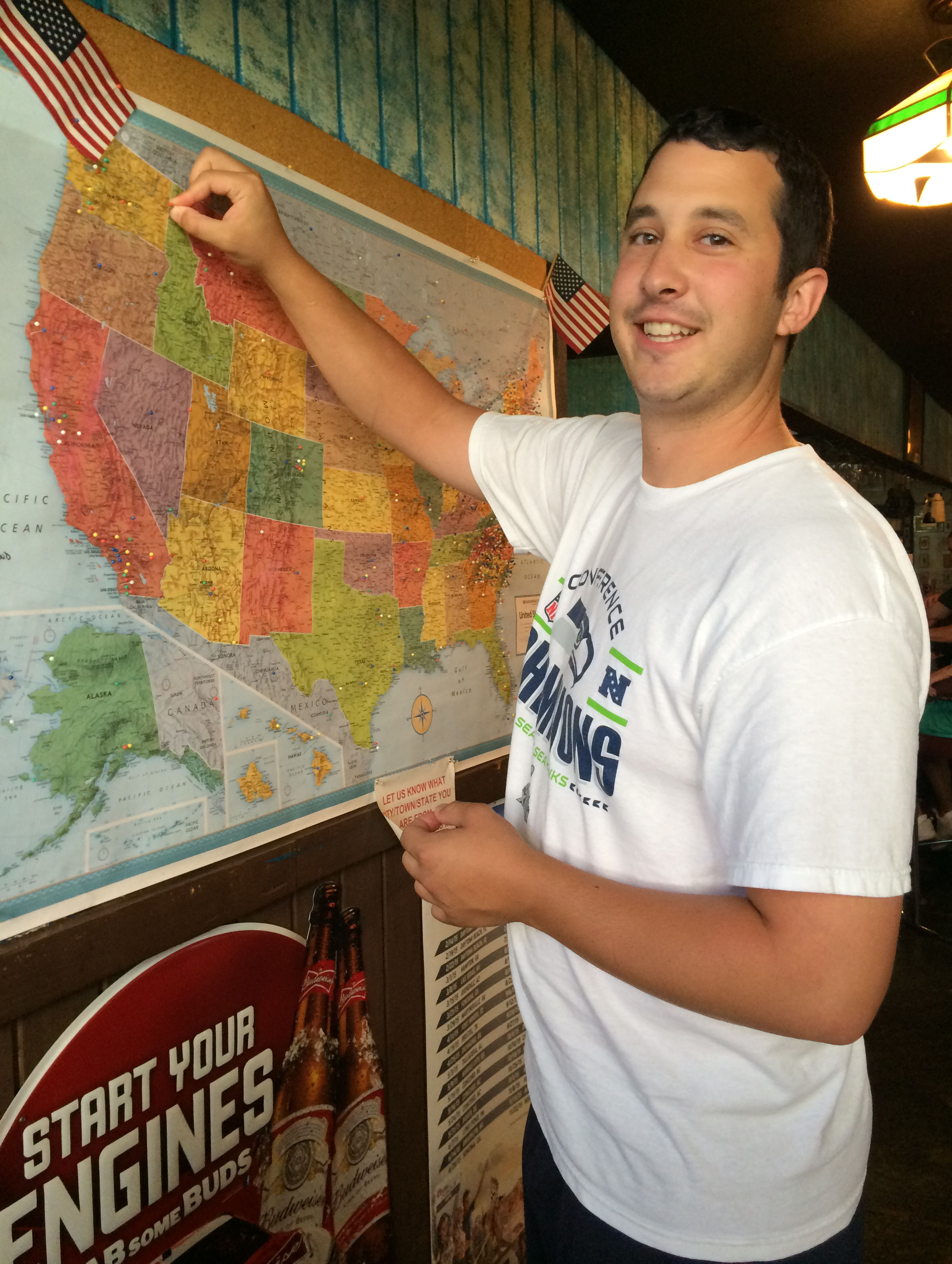 Glen pinned his hometown on the big map in the bar.