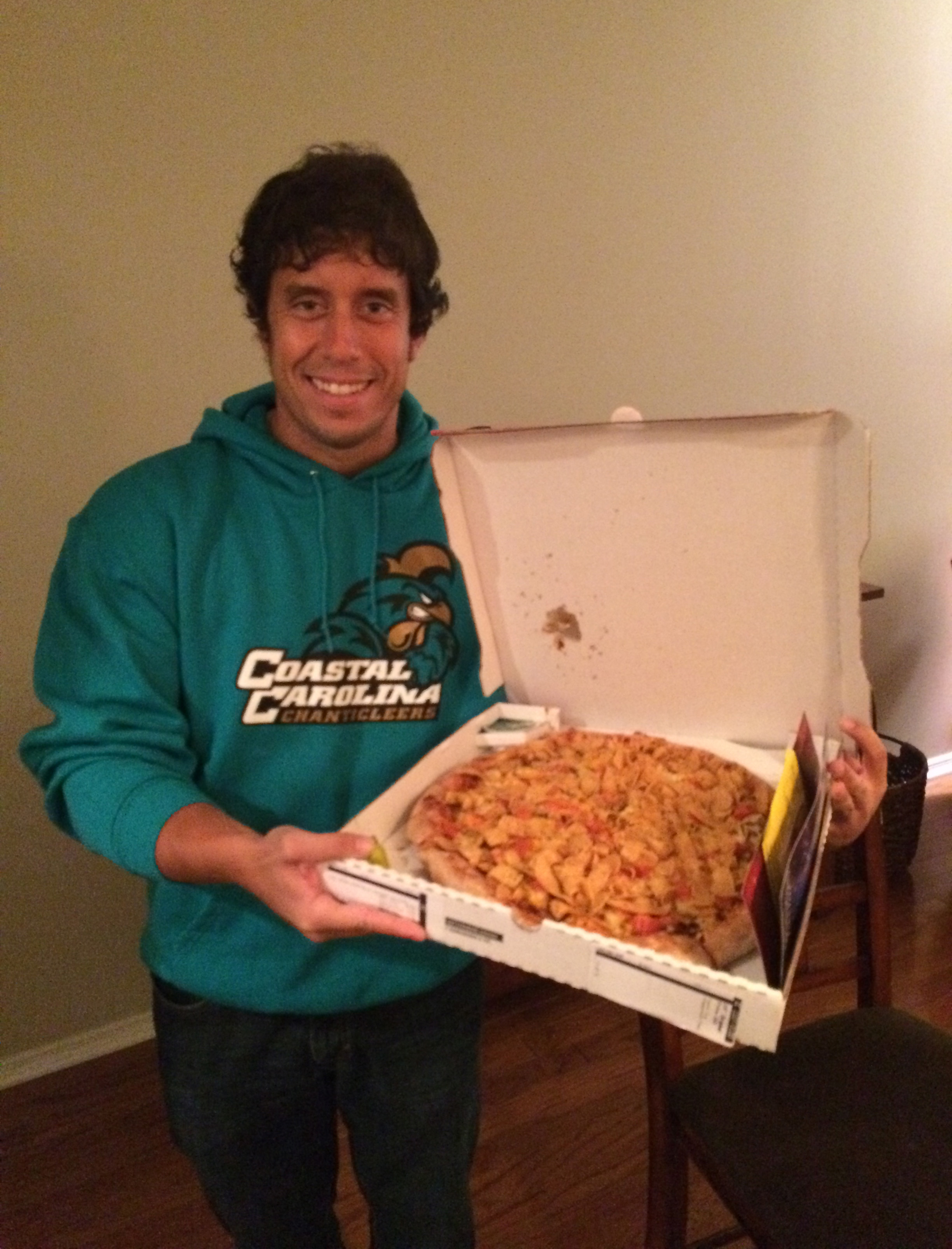 Me holding the Fritos Chili Pizza from Papa John's.