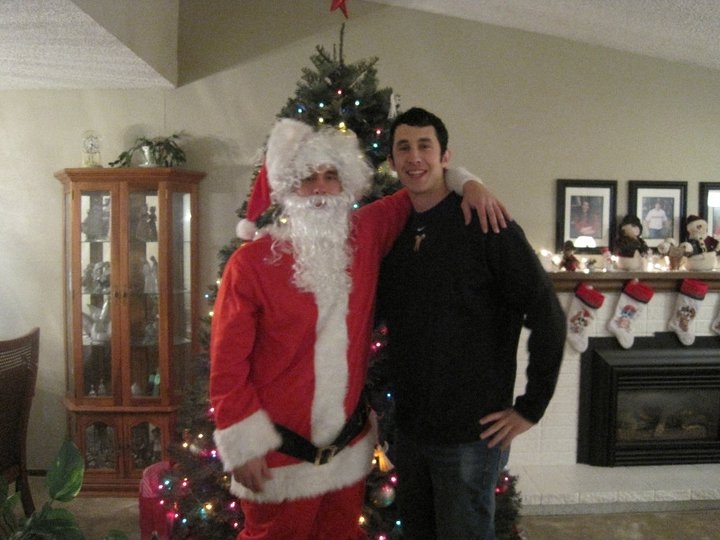 This photo was taken five years ago this month. After I surprised my mom I took a photo with my bro in front of the tree.