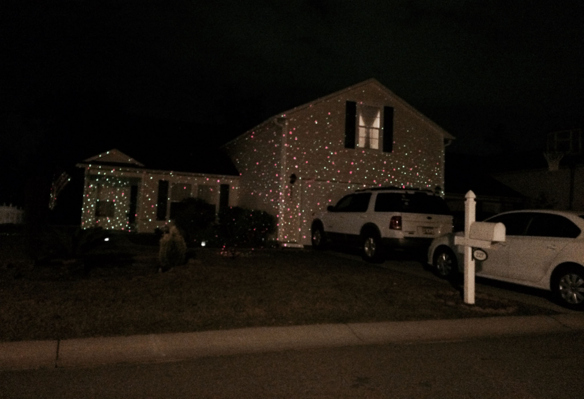 say hello to laser christmas lights i took a photo of this house in sids neighborhood last night this home is