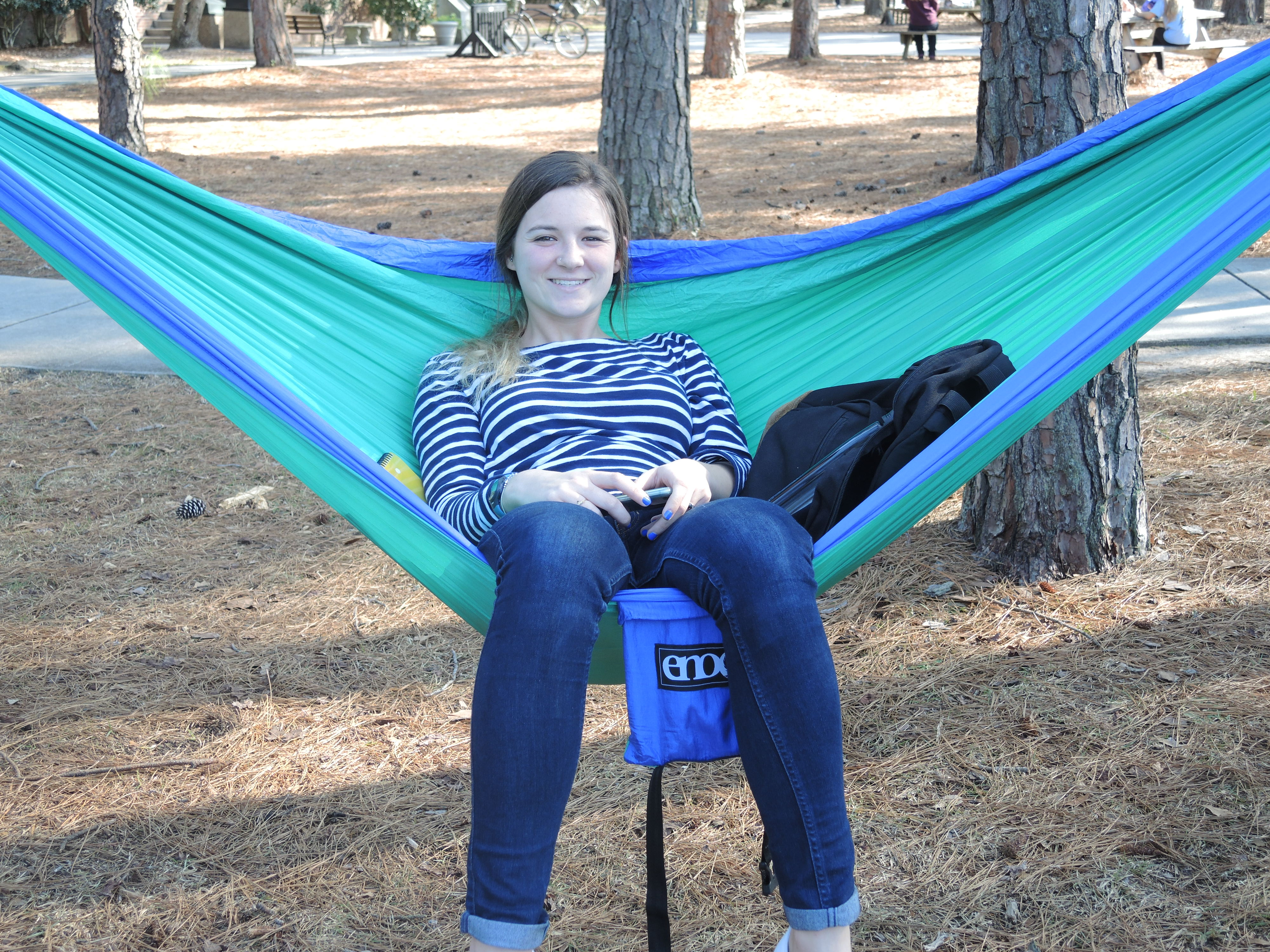 This student set up her hammock in the shade. Yes, there is a hammock club at Coastal.