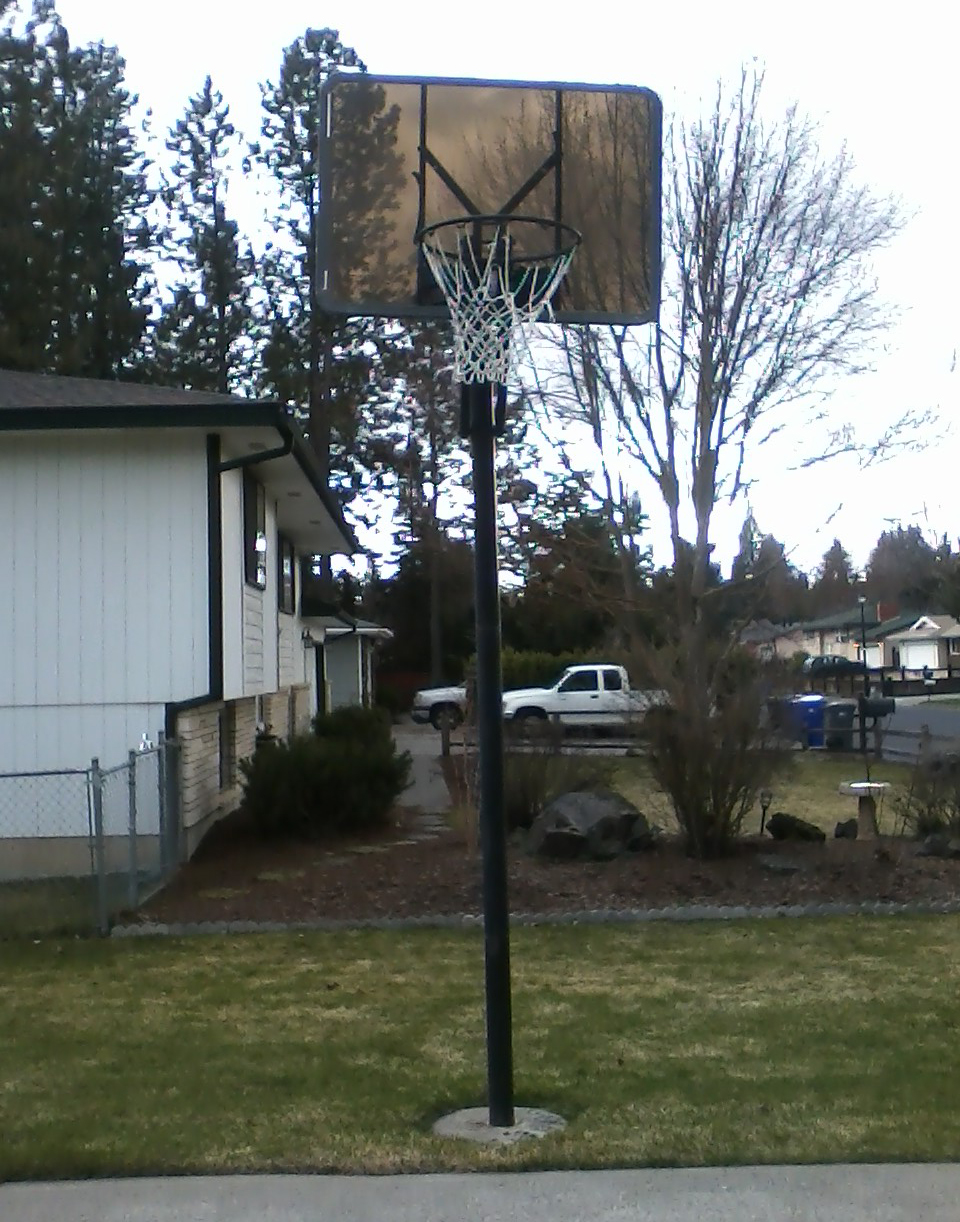 This was the basketball hoop that received hours and hours and hours of use. The cement around the bottom of the pole has our handprints on it (thanks mom for taking this photo).