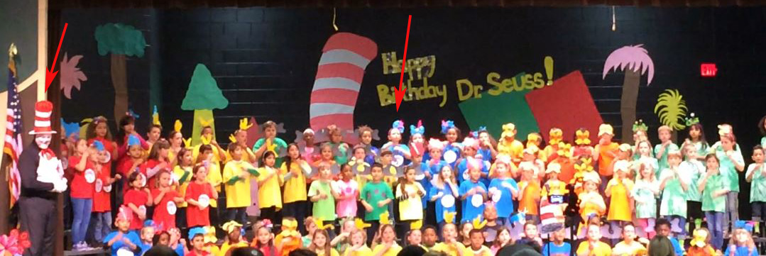 The Dr. Seuss performance from Tuesday night (Terrible photo because I captured it from a video I took). One arrow points to Russell and the other one points to a wonderful Cat in the Hat.