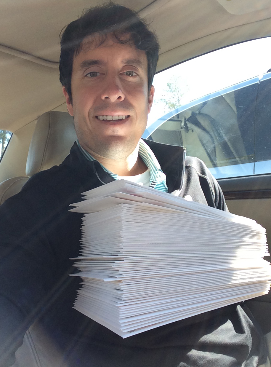 Me holding our wedding invites right before I brought them into the post office.