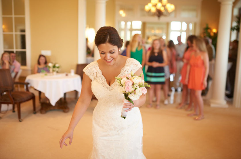 Sidney getting ready to throw the bouquet (photo courtesy of Nicholas Gore Weddings Photography).