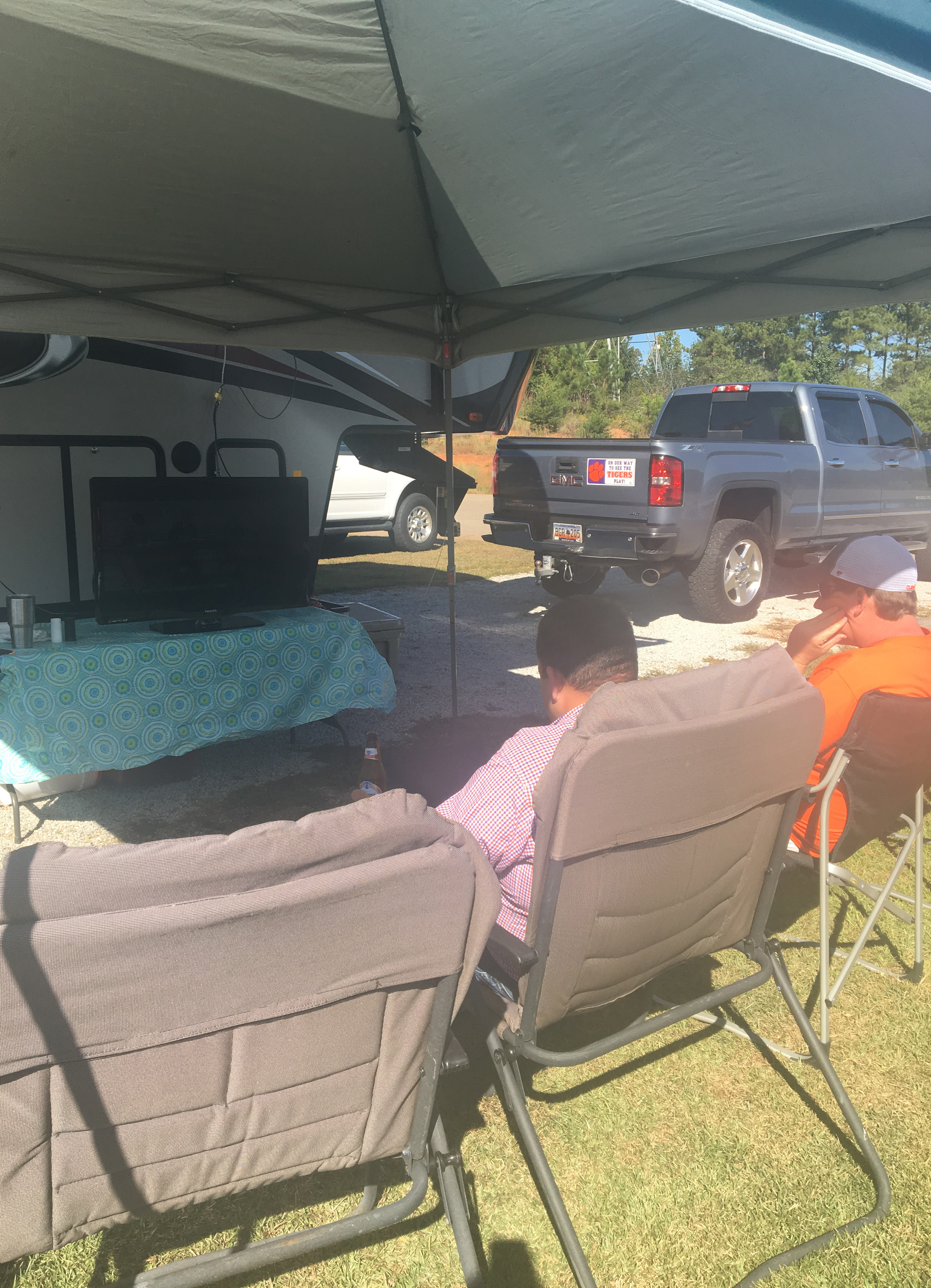 This is what the TV and chairs setup looked like. Jon and John Henry are sitting down enjoying College Gameday (photo courtesy of Courtney).