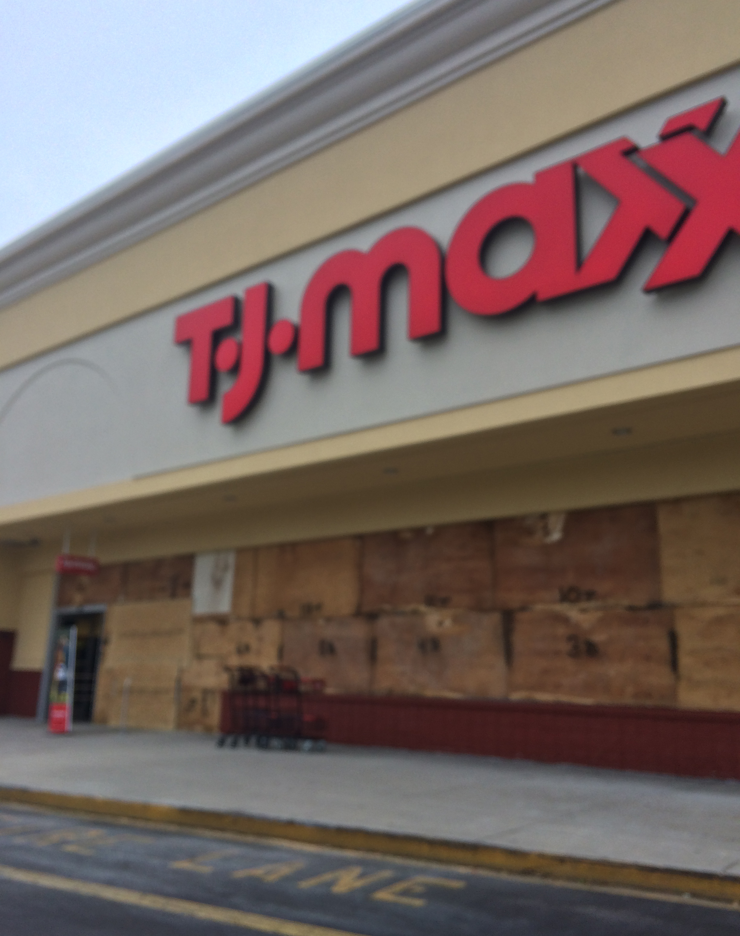 I took this photo of a TJ Maxx this morning as I was coming back from the gym. The store boarded up its windows in preparation for the storm.