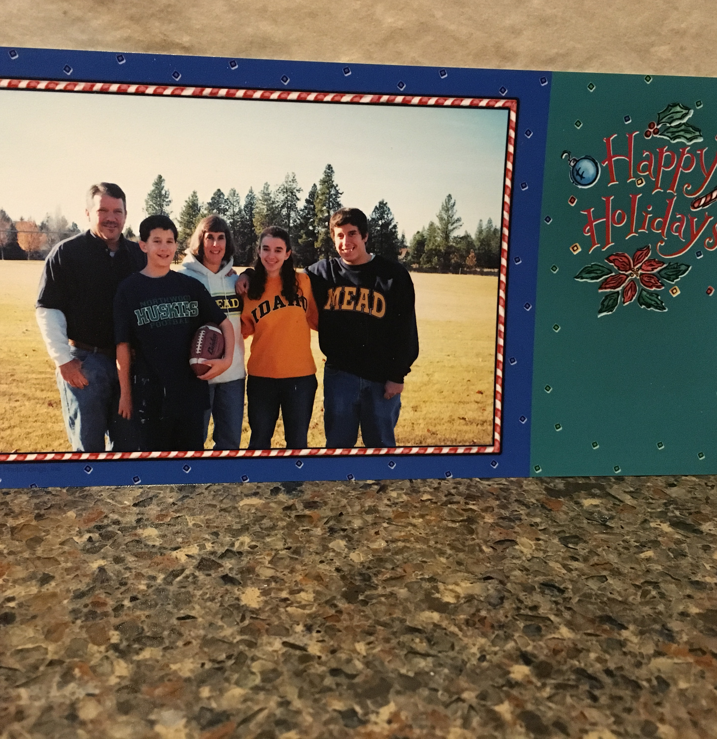 This Christmas card is from 2001. Glen is wearing his middle school shirt, I am wearing my high school sweatshirt, and my sister is wearing her college sweatshirt. I really like the colors in this photo.