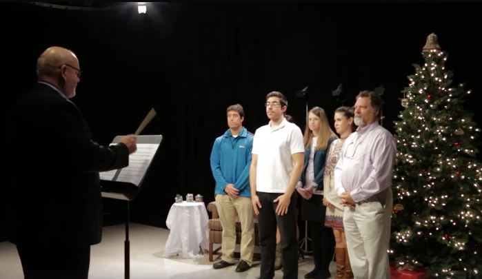 The video starts with a subdued choir scene but then takes off. (This is a screenshot of the video).