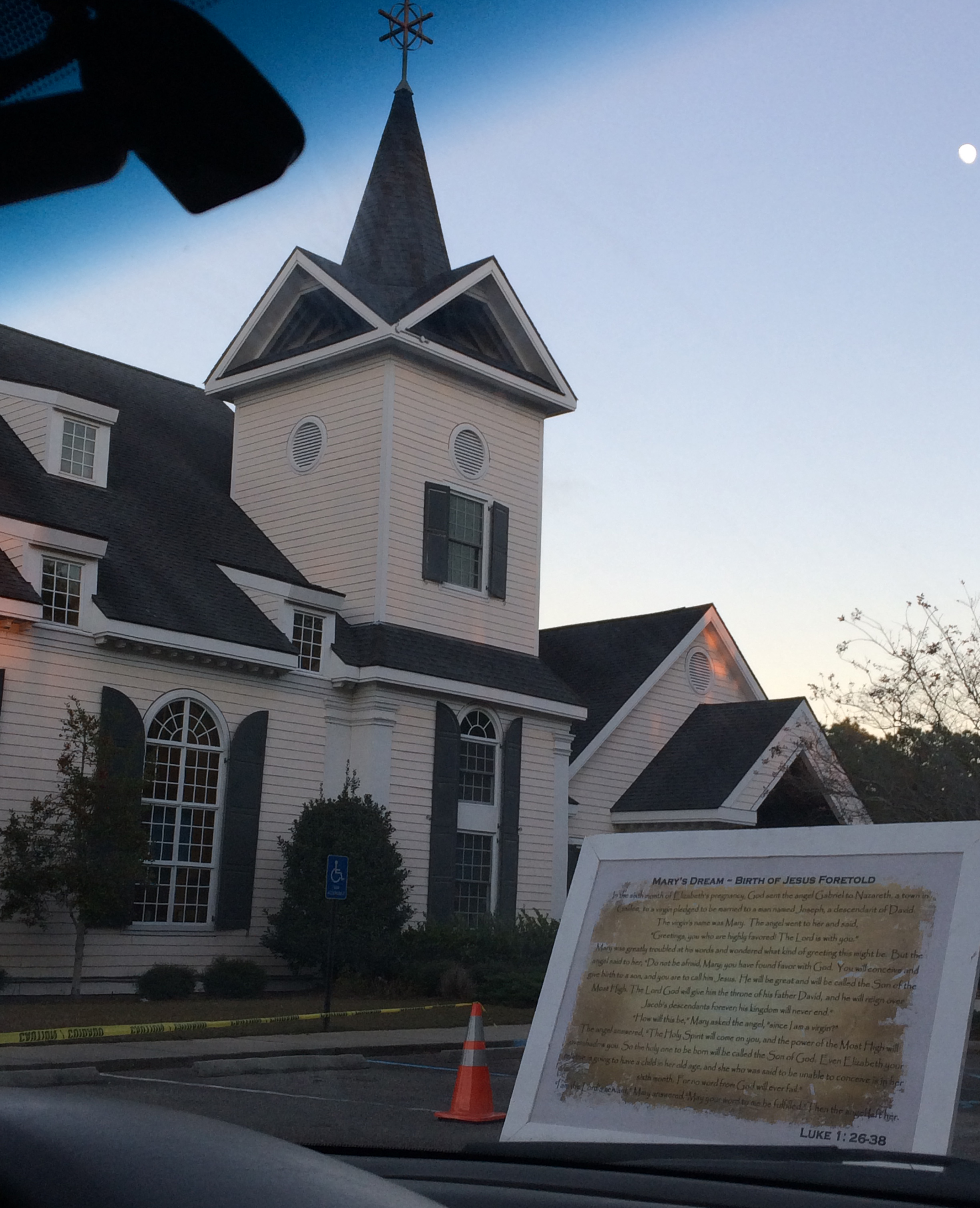 This was our view right after we turned into the property of the Church of the Resurrection in Surfside Beach. The church itself is on the left and the board you see right in front of our dash has scripture on it, describing one of the seven scenes of the Drive-Thru Nativity.