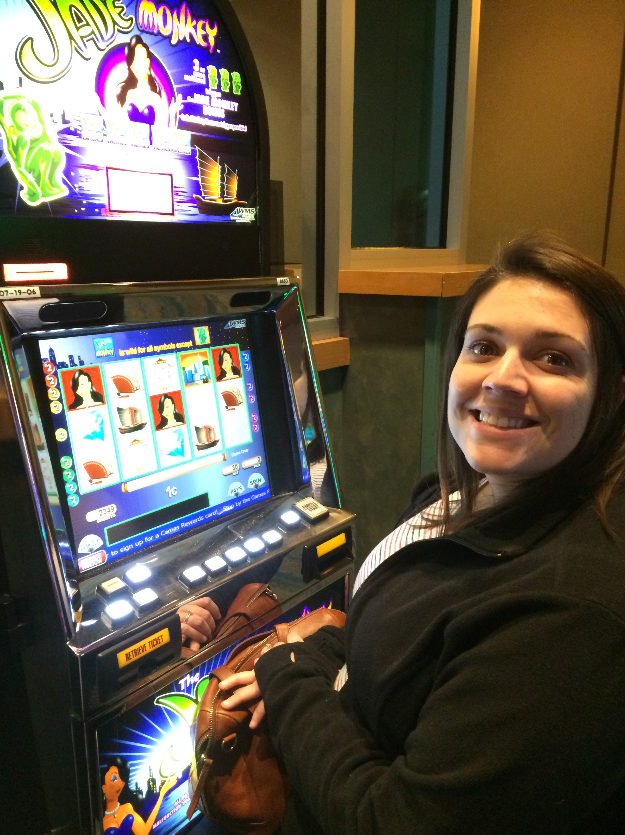 Sidney winning money at the slot machine at Northern Quest.
