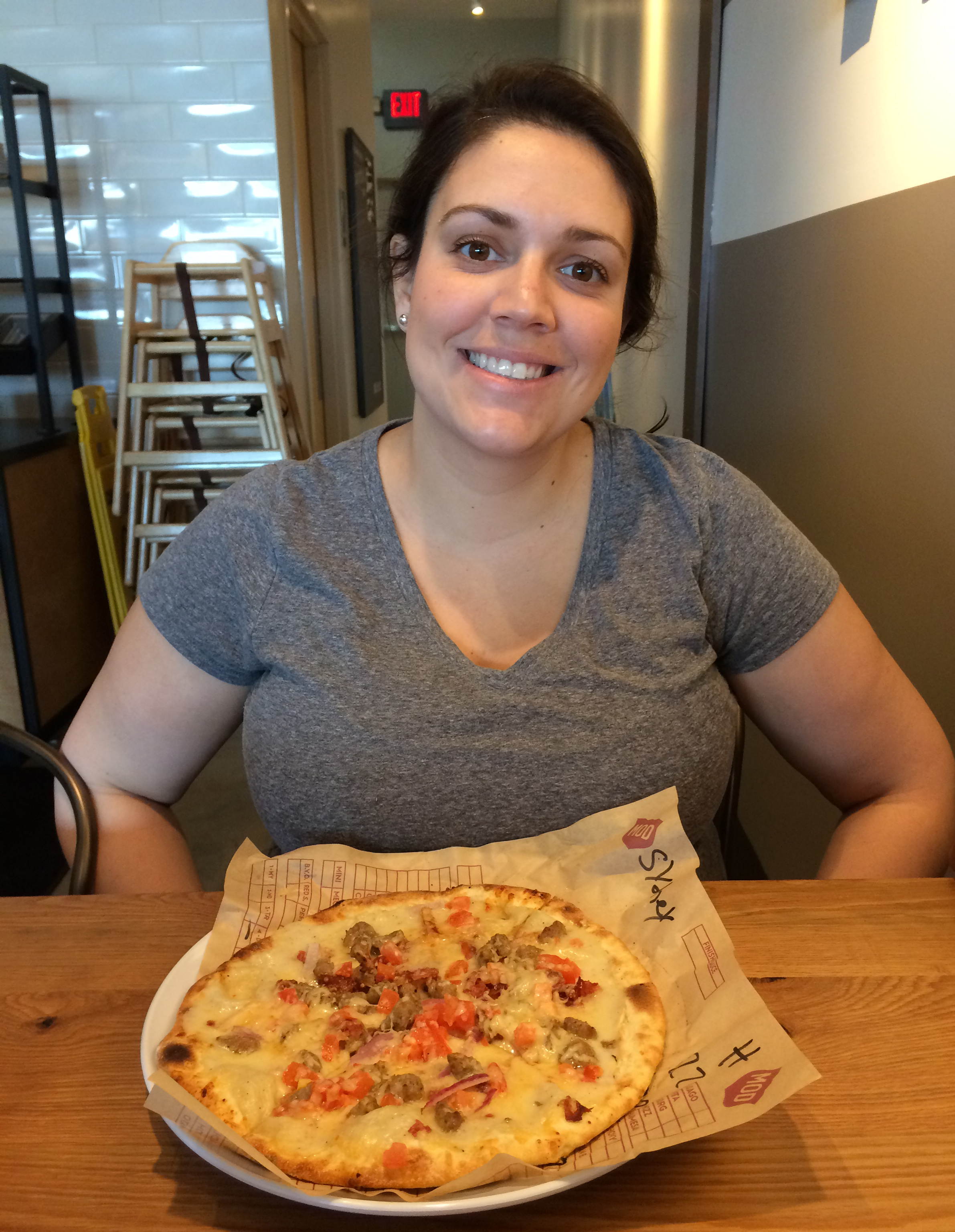 This is Sidney with her pizza. She got the Dominic, a MOD Pizza classic.