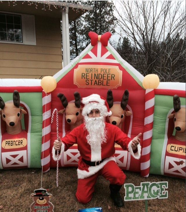 some holiday inflatables are pretty basic others are more involved i took this photo in front of a reindeer stable blow up in my parents neighborhood - Inflatable Christmas Lawn Decorations